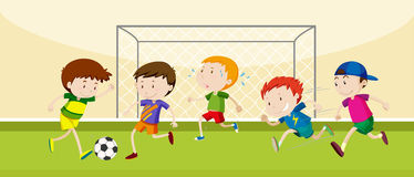 Boys playing soccer in the field Stock Photo