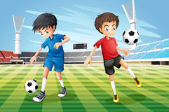 Boys playing soccer in the field Stock Image