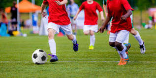 Boys playing soccer football match. International sport competition for youth soccer teams. Stock Photos