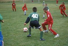 Boys playing in a soccer game Stock Image