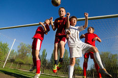 Boys playing soccer royalty free stock image