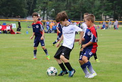 The boys are playing soccer. The Soccer match at the tournament Stock Photo