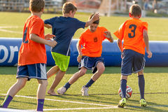Boys playing soccer Stock Images