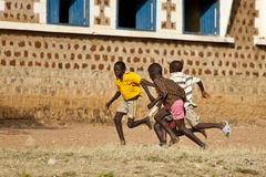 Boys playing soccer, South Sudan. TORIT, SOUTH SUDAN-FEBRUARY 20 2013: Unidentified boys play soccer in the town of Torit, South Sudan royalty free stock photography