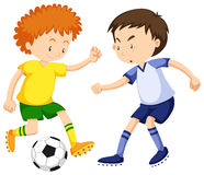 Boys playing soccer together Stock Photography