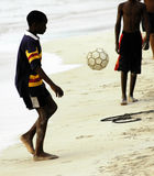 Boys playing socker. Negril beach, jamaica Royalty Free Stock Photography