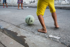 Boys playing street soccer Royalty Free Stock Image