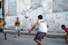Boys playing street soccer Stock Image