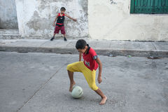 Boys playing street soccer Royalty Free Stock Images