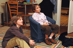 Boys playing video games. Two boys playing video games in a childs room Stock Photo