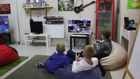 Boys playing video games stock video