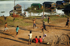Boys playing volleyball in Chong Kneas Cambodia Stock Photos