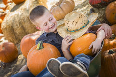 Boys Playing in Wheelbarrow at the Pumpkin Patch Royalty Free Stock Photos