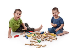 Boys playing whit blocks Stock Photos