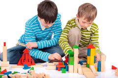 Boys playing with wood blocks Royalty Free Stock Photo