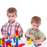 Boys playing with wooden cubes Stock Images