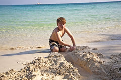 Boys plays at the  beach with sand Stock Images