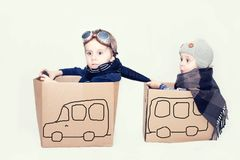 Boys plays with cardboards cars royalty free stock image