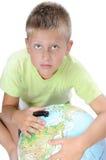 Boys pointing on world globe Stock Image