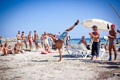 Boys Practicing Capoeira on Ibiza B Stock Photo