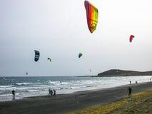 Boys practicing kitesurfing Royalty Free Stock Image