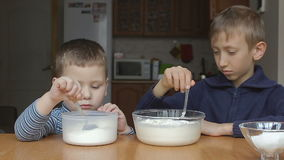 Boys prepare dough and rolling flour and milk stock video footage