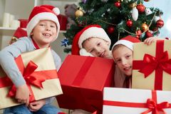 Boys with presents Stock Images