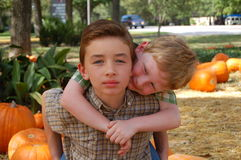 Boys in Pumpkin Patch Royalty Free Stock Photos
