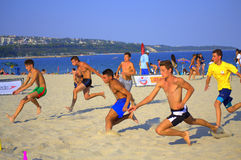 Boys racing on the beach Royalty Free Stock Images