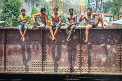 Boys on a rail bridge Royalty Free Stock Images