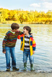Boys in rain boots Royalty Free Stock Photography
