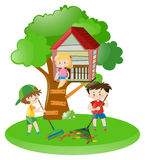 Boys raking leaves and girl on treehouse Royalty Free Stock Image