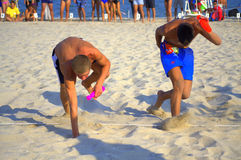 Boys reaching the goal. Racing boys snatching the pins at the final line of a run, of the 5th National tournament-Young lifeguard on Varna beach,Bulgaria Stock Photos
