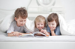 Boys read book stock image