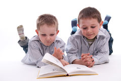 Boys reading a book Royalty Free Stock Image