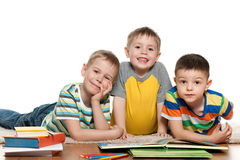 Boys reading on the floor Stock Photo