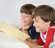 Boys Reading a Story in Bed Stock Image