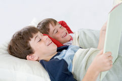 Boys Reading a Story in Bed Stock Photography
