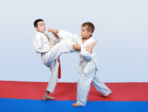 Boys with a red and white belt do paired exercises  karate. Boys with a white and red belt do paired exercises  karate Stock Photo