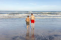 Boys relaxing at the beach Royalty Free Stock Photo