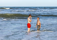 Boys relaxing at the beach Royalty Free Stock Images