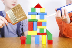 Boys  repair the house from cubes Royalty Free Stock Photography