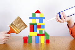 Boys  repair the house from cubes Royalty Free Stock Photo