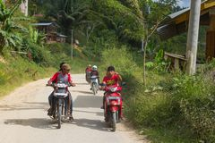 Boys riding motorbikes in Indonesia Royalty Free Stock Photography
