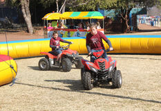 Boys riding on quad bikes at Festival Royalty Free Stock Photo