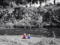 Boys by the river stock images