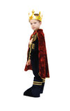 Boys rules. Small boy dresses up in a costume fit for a king.  He comes complete with crown and scepter.  He is wearing his Halloween costume Stock Image