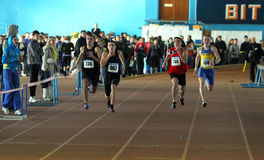 Boys run relay race. Unidentified boys run 200 meters race on Ukainian Junior Track and Field Championships on January 28, 2012 in Zaporizhia, Ukraine Stock Image