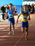 Boys run relay race. Unidentified boys run relay race on Ukainian Junior Track and Field Championships on January 28, 2012 in Zaporizhia, Ukraine Stock Images