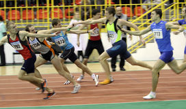 Boys run relay race. Unidentified boys run relay race on Ukainian Junior Track and Field Championships on Ukrainian Track & Field Championships on February 18 royalty free stock images